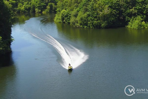 AVM Visuals, aerial photography of jet ski on lake.