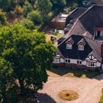 Aerial photography of country house rooftops.