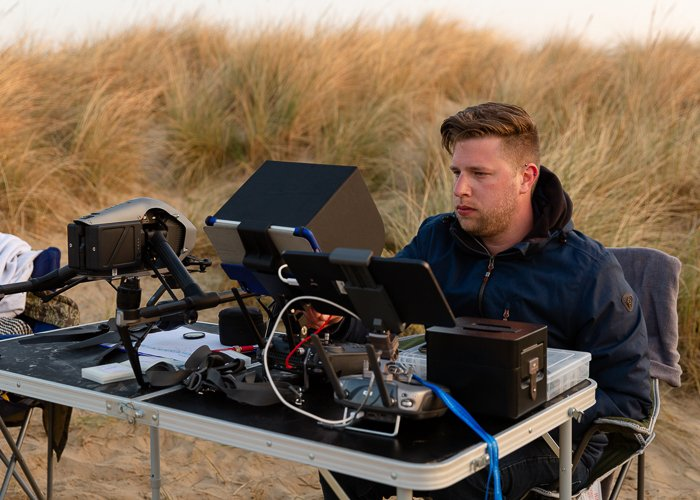 Chris of AVM Visuals operating an Unmanned Aircraft System (UAS) or drone for aerial photography.